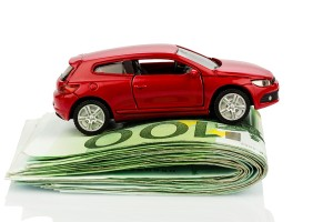 a car standing on euro bills. costs for the purchase of automobi