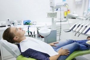 Patient Sitting On Dental Chair